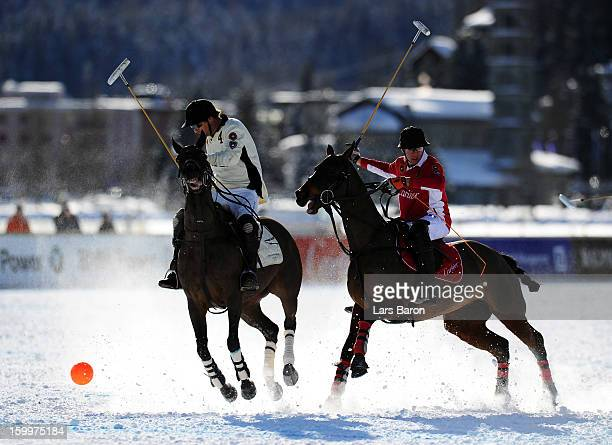 Tarquin Southwell of Great Britain and SAL Oppenheim is challenged by Max Charlton of Great Britain and Cartier during the Polo World Cup on Snow...