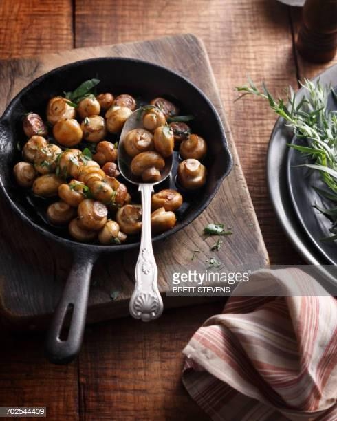 Tarragon button mushrooms in frying pan