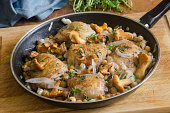 Tarragon chicken with chickpeas and girolles in a pan