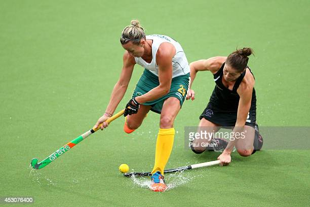 Tarryn Bright of South Africa is tackled by Krystal Forgesson of New Zealand in the Women's Bronze Medal Match at Glasgow National Hockey Centre...