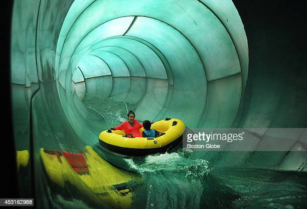 Tarsha Ancrum and her son Denzel of Lynn head down one of the giant water slides Great Wolf Lodge is a new waterpark resort