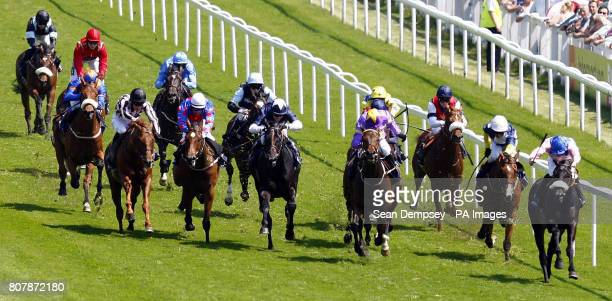 Tartan Gigha ridden by Kieren Fallon goes on to win the Investec Mile handicap during Ladies Day at Epsom Downs Racecourse Surrey