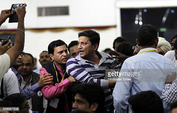 Tarun Yadav protest against AAP MLA Girish Soni in front of AAP convener Arvind Kejriwal during the launch of the AAP traders Wing at Constitution...