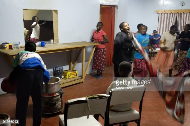 Tasaru sponsored girls sing and dance while preparing Christmas meal December 24 2006 in Narok Kenya The Tasaru Safehouse supports board lodging and...