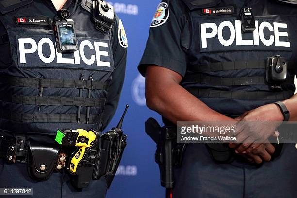 TORONTO ON MAY 15 Taser and camera wore by police officer during a press conference introducing new bodyworn police video cameras May 15 2015 Toronto...