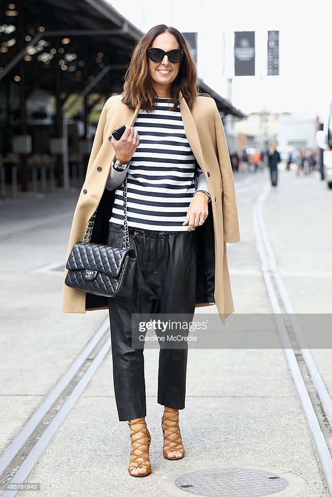Tash Sefton wearing Bassike shirt and pants Hermes clutch Chanel handbag Zara Jacket and Isabel Marant shoes at MercedesBenz Fashion Week Australia...