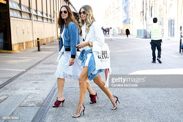Tash Sefton wearing JW Anderson outfit and NO 21 heels with Elle Ferguson wearing Scanlan Theodore heels Bassike shorts HM top and Dinosaur Designs...