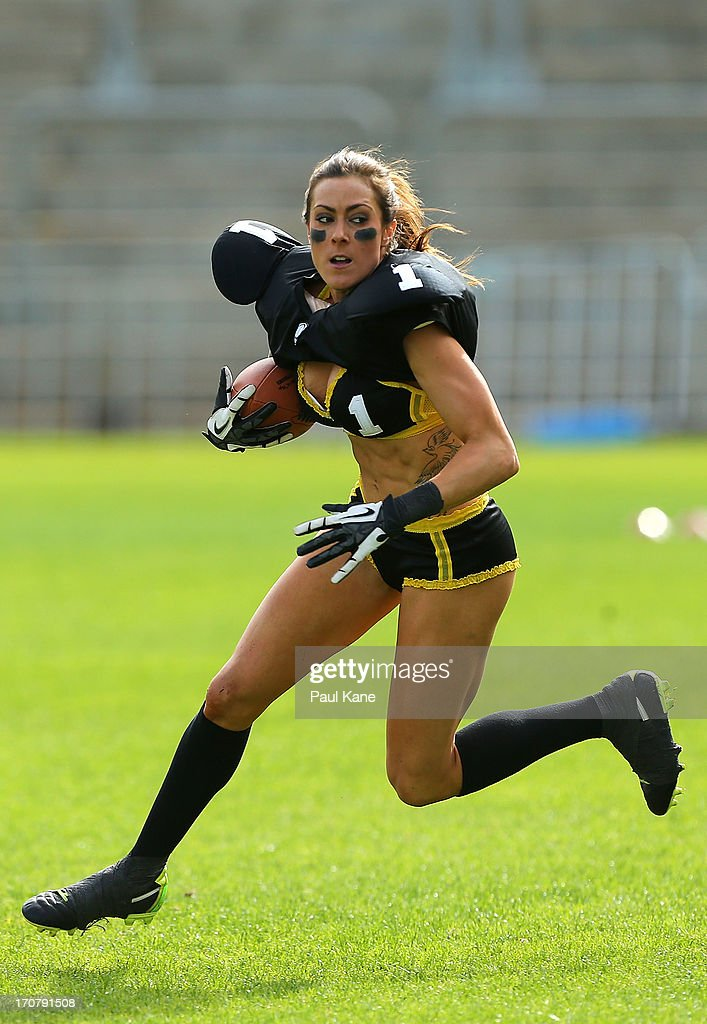 Tash Sergi of the Western Australian Angels runs with the ball in an exhibition game during a Legends Football League (LFL) media day at nib Stadium on June 18, 2013 in Perth, Australia.