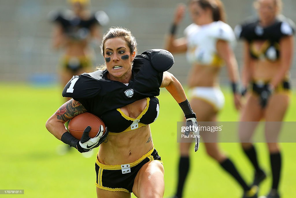 Tash Sergi runs with the ball in an exhibition game during a Legends Football League (LFL) media day at nib Stadium on June 18, 2013 in Perth, Australia.