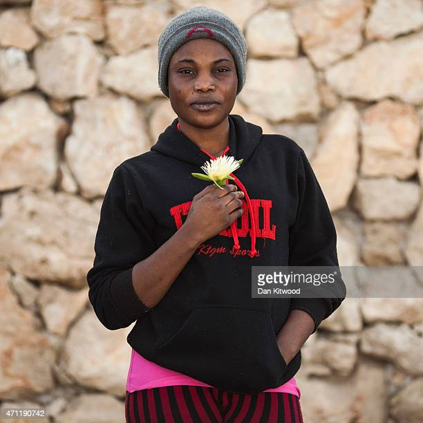 Tasha from Nigeria poses for a portrait on April 23 2015 in Lampedusa Italy After making the journey from her home country Tasha spent one day on a...