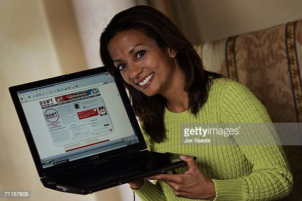 Tasha Joseph the creator of the Don'tDateHimGirlcom web site holds her computer showing the site's home page at her home office June 8 2006 in Miami...