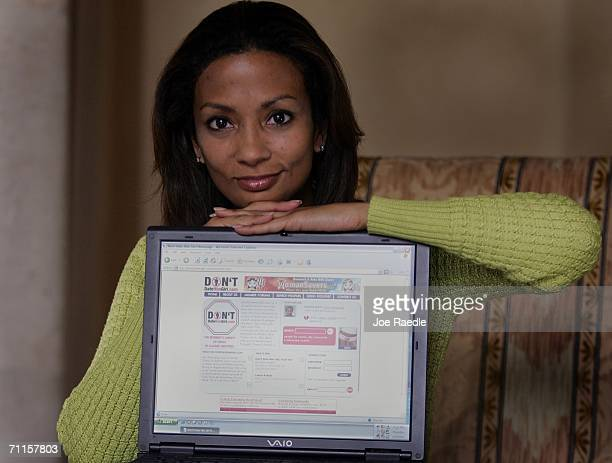 Tasha Joseph the creator of the Don'tDateHimGirlcom web site poses with her computer showing the site's home page at her home office June 8 2006 in...