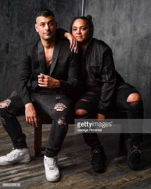 Tasha The Amazon and guest pose at the 2017 Juno Awards Portrait Studio at the Canadian Tire Centre on April 1 2017 in Ottawa Canada