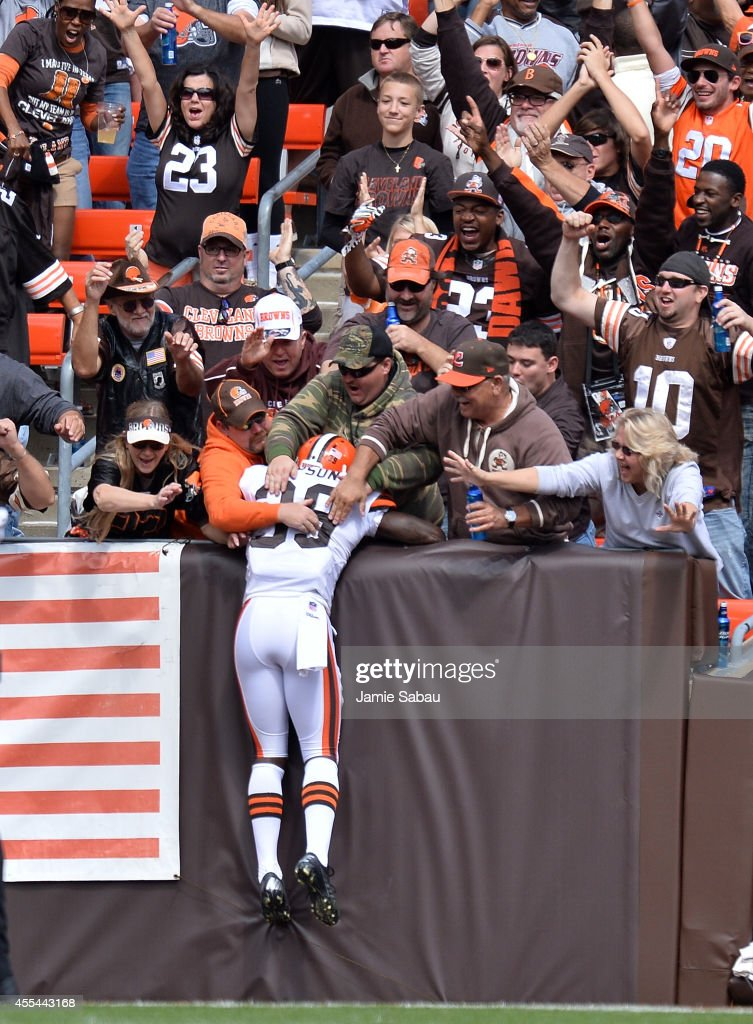 Tashaun Gipson #39 of the Cleveland Browns celebrates his interception return for a touchdown with fans during the second quarter against the New Orleans Saints at FirstEnergy Stadium on September 14, 2014 in Cleveland, Ohio.