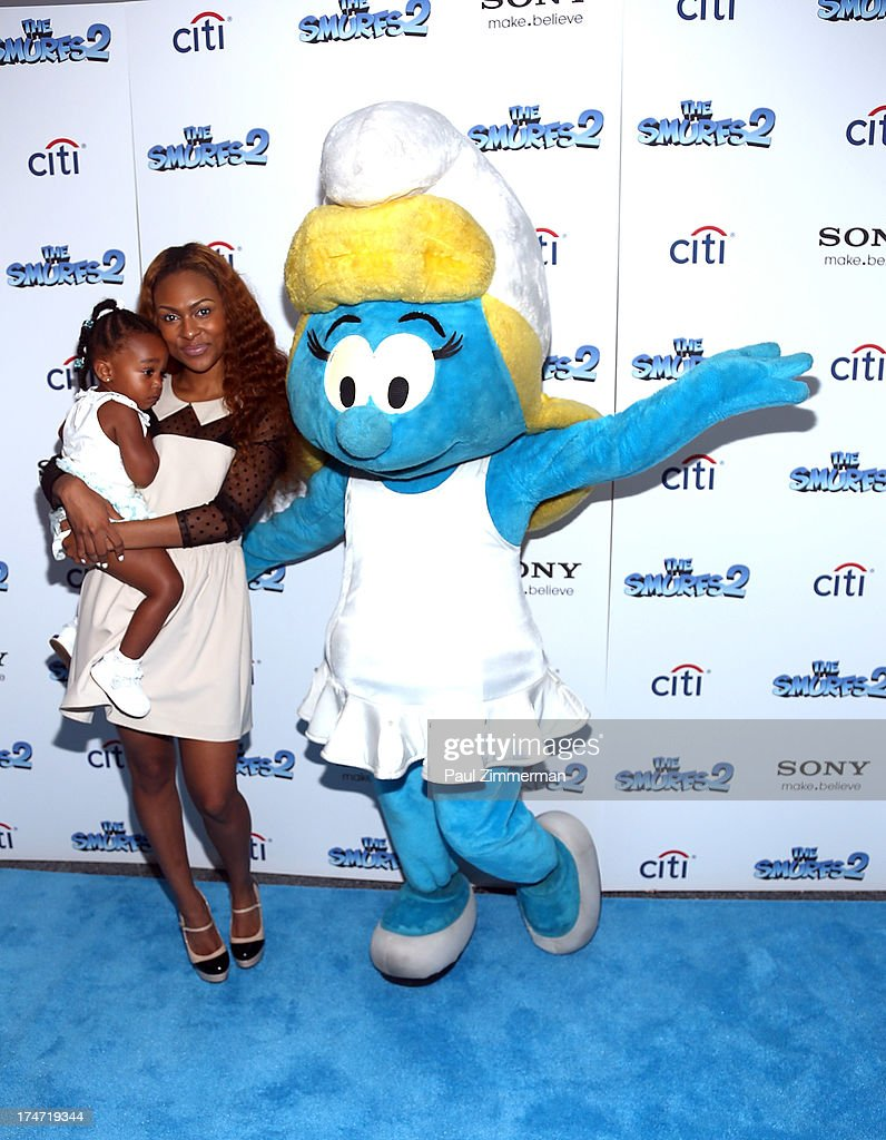 Tashiana Washington and Smurfette attend 'The Smurfs 2' New York Blue Carpet Screening at Lighthouse International Theater on July 28, 2013 in New York City.