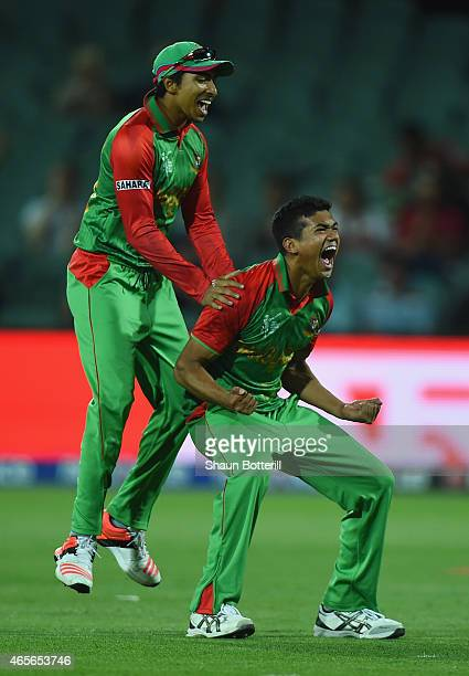 Taskin Ahmed of Bangladesh celebrates with teammate Soumya Sarkar after taking the wicket of James Taylor of England during the 2015 ICC Cricket...