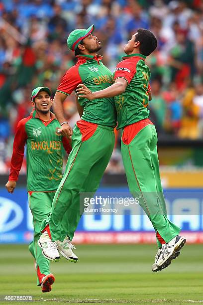 Taskin Ahmed of Bangladesh is congratulated by Mashrafe Mortaza after getting the wicket of Ajinkya Rahane of India during the 2015 ICC Cricket World...
