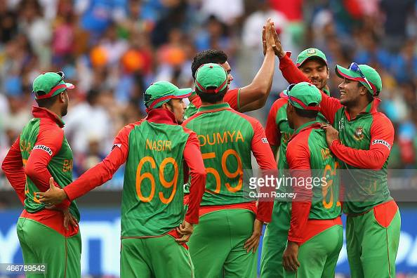 Taskin Ahmed of Bangladesh is congratulated by team mates after getting the wicket of Ajinkya Rahane of India during the 2015 ICC Cricket World Cup...