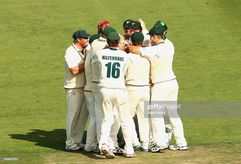 Tasmania celebrate the run out of Cameron White of Victoria by George Bailey during day four of the Sheffield Shield match between the Tasmania Tigers and the Victoria Bushrangers at Blundstone Arena on March 17, 2013 in Hobart, Australia.