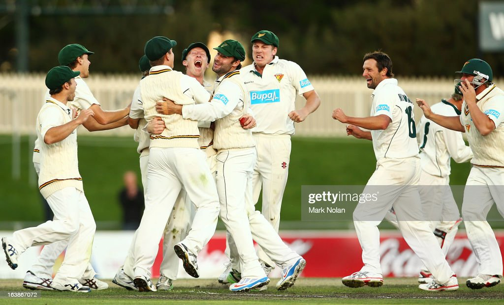 Tasmania celebrate winning during day four of the Sheffield Shield match between the Tasmania Tigers and the Victoria Bushrangers at Blundstone Arena on March 17, 2013 in Hobart, Australia.