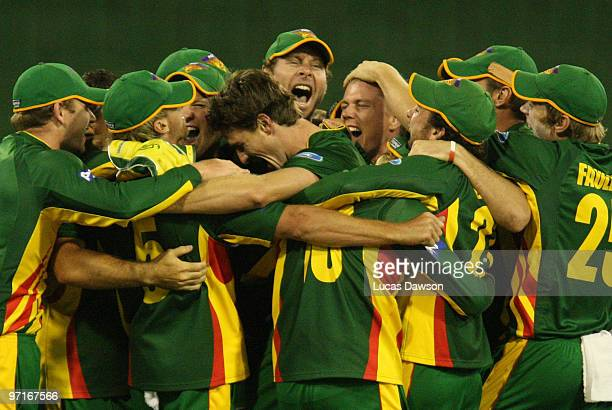 Tasmania players celebrate after winning the Ford Ranger Cup Final match between the Victorian Bushrangers and the Tasmanian Tigers at the Melbourne...