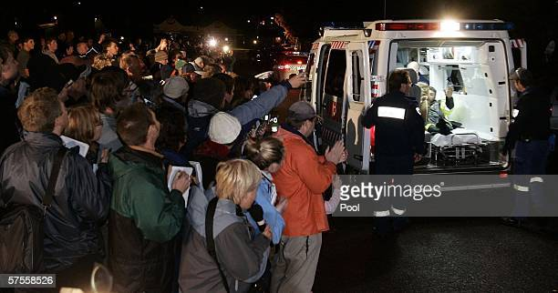 Tasmanian miner Brant Webb waves from the back of an ambulance after being rescued from the Beaconsfield gold mine May 9 2006 in Beaconsfield...