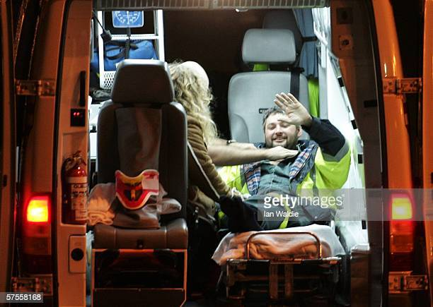 Tasmanian miner Todd Russell waves from the back of an ambulance after being rescued from the Beaconsfield gold mine May 9 2006 in Beaconsfield...