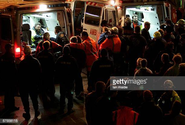 Tasmanian miners Todd Russell and Brant Webb sit in ambulances after being rescued from the Beaconsfield gold mine May 9 2006 in Beaconsfield...