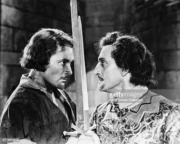 Tasmanianborn actor Errol Flynn as Robin Hood crosses swords with Basil Rathbone as the villainous Sir Guy of Gisbourne in the film 'The Adventures...