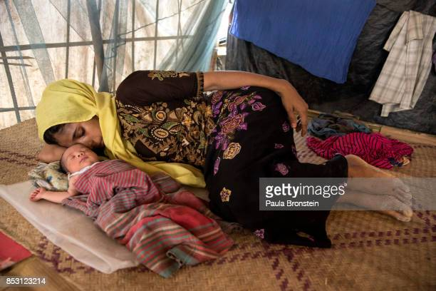 Tasmin Ara age 21 rests with her two day old baby girl September 24 2017 in Balukhali camp Cox's Bazar Bangladesh Over 429000 Rohingya refugees have...