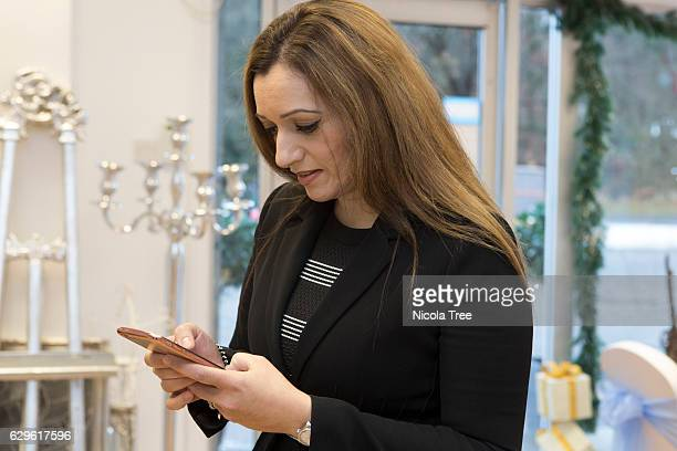 Tasmina AhmedSheikh SNP MP for Ochil and South Perthshire checks her mobile as she visits a local business 'Party People On Line' in Alloa on...