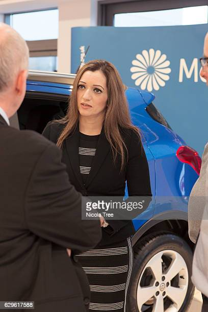 Tasmina AhmedSheikh SNP MP for Ochil and South Perthshire presenting a Mobility car to a constituent at Arnold Clark Vauxhall dealership on December...
