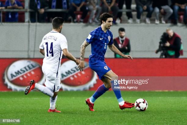 Tasos Bakasetas of Greece in action against Sime Vrsaljko of Croatia during the World Cup Russia 2018 European Qualifiers match between Greece and...