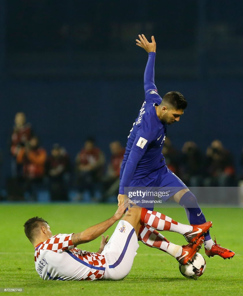 Tasos Bakasetas (L) of Greece is challenged by Dejan Lovren (L) of Croatia during the FIFA 2018 World Cup Qualifier Play-Off: First Leg between Croatia and Greece at Stadion Maksimir on November 9, 2017 in Zagreb, Croatia