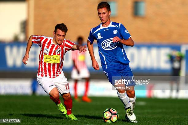 Tass Mourdoukoutas of Olympic FC dribbles the ball as Marcus Donatiello of Parramatta gives chase during the NSW NPL Men's match between Sydney...