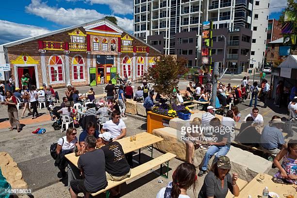 Taste Theatre and people at outdoor tables at Taste of Tasmania: Festival of Tasmanian Food and Wine.