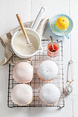 Tasty and homemade donuts with white icing