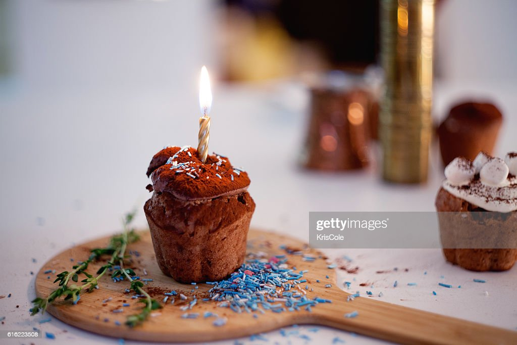 tasty birthday cupcake with candle on the table, blurred background : Stockfoto