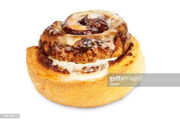 A tasty cinnamon bun with icing on a white background