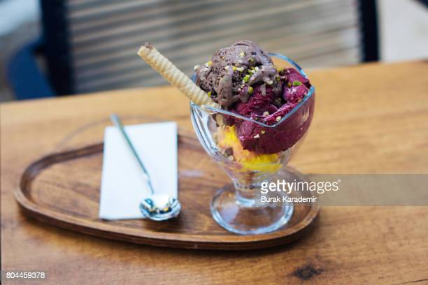 Tasty icecream ball in glass on the table