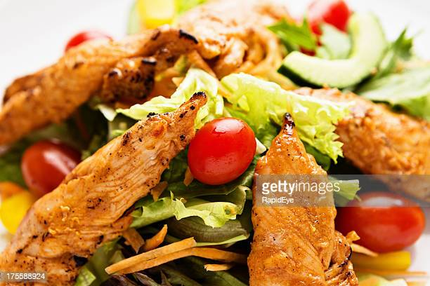 Tasty low-carb meal of spiced chicken and a mixed salad