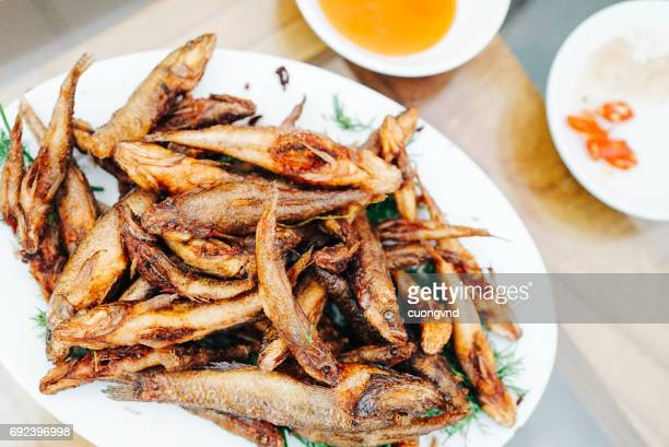 Tasty roasted smelt fish with salt and herbs