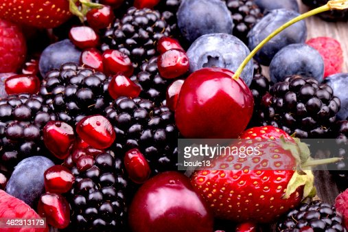 tasty summer fruits on a wooden table : Stock Photo