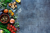 Garden vegetables with fresh ingredients for healthily cooking on vintage background, top view, banner. Vegan or diet food concept. Background layout with free text space.