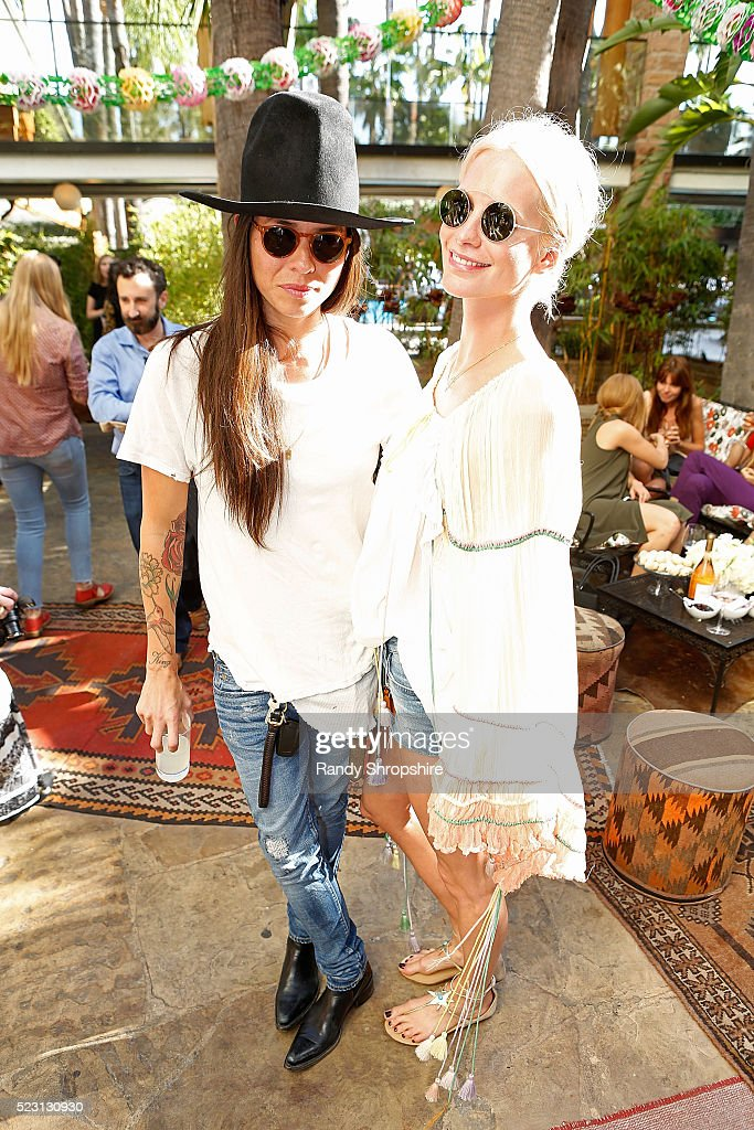 Tasya Van Ree (L) and Poppy Delevingne attend the Villoid garden tea party hosted by Alexa Chung at the Hollywood Roosevelt Hotel on April 21, 2016 in Hollywood, California.