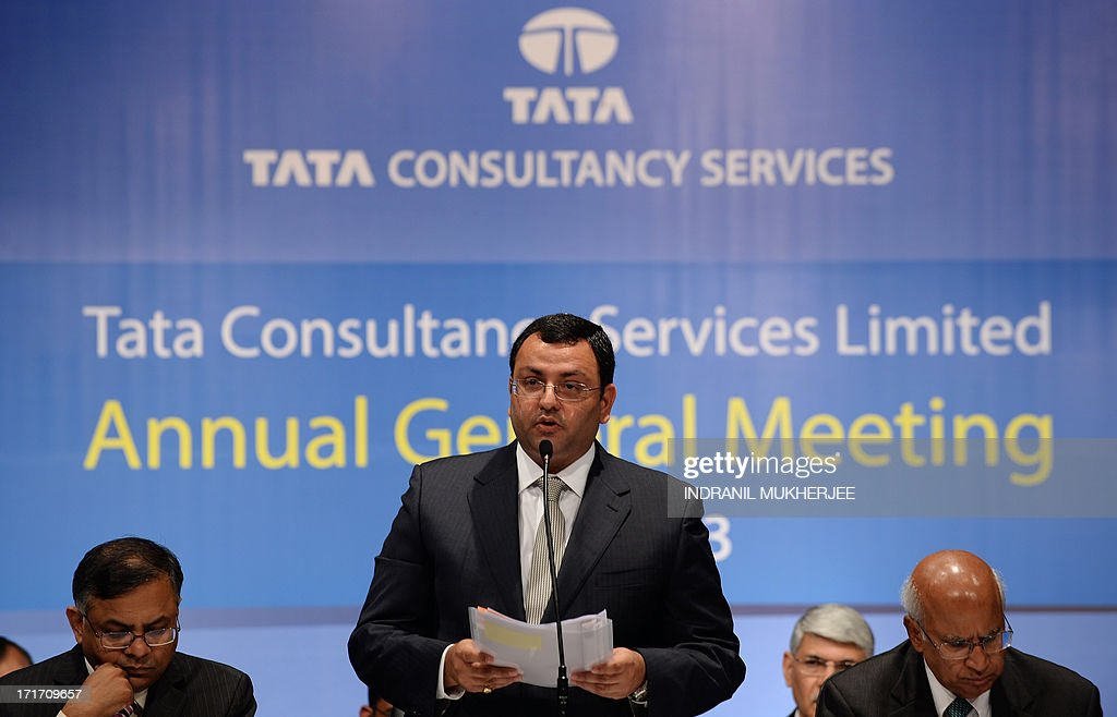 Tata Group chairman, Cyrus Mistry, (C), as company chief executive N. Chandrasekaran (L) and non-executive vice chairman S. Ramadorai (R) look on, addresses his first and the 9th Annual General Meeting of Tata Consultancy Services in Mumbai on June 28, 2013. India's biggest IT outsourcing firm, Tata Consultancy Services, popularly known as TCS and part of the steel-to-tea Tata conglomerate, counts blue-chip companies such as British Airways, Microsoft and Sony among its main clients.
