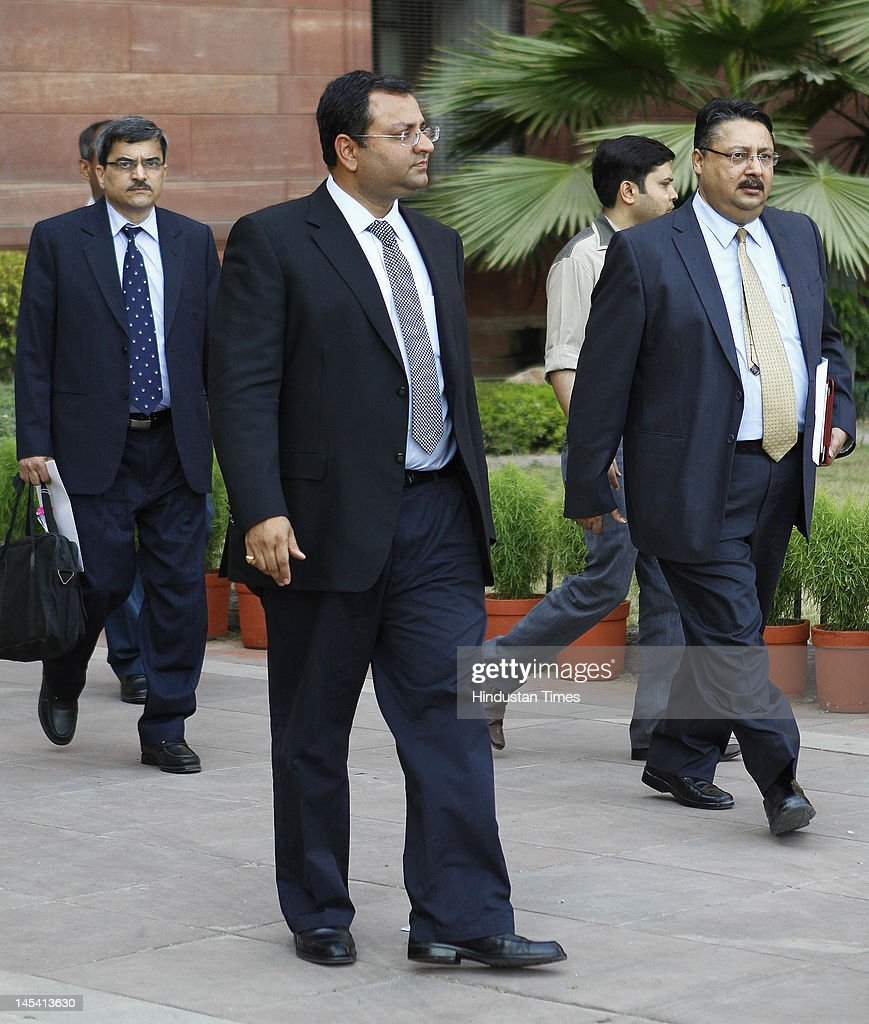 Tata Group Chairman <a gi-track='captionPersonalityLinkClicked' href=/galleries/search?phrase=Cyrus+Mistry&family=editorial&specificpeople=8705051 ng-click='$event.stopPropagation()'>Cyrus Mistry</a> (C) with colleagues after a meeting at the Finance Ministry on May 29, 2012 in New Delhi, India.