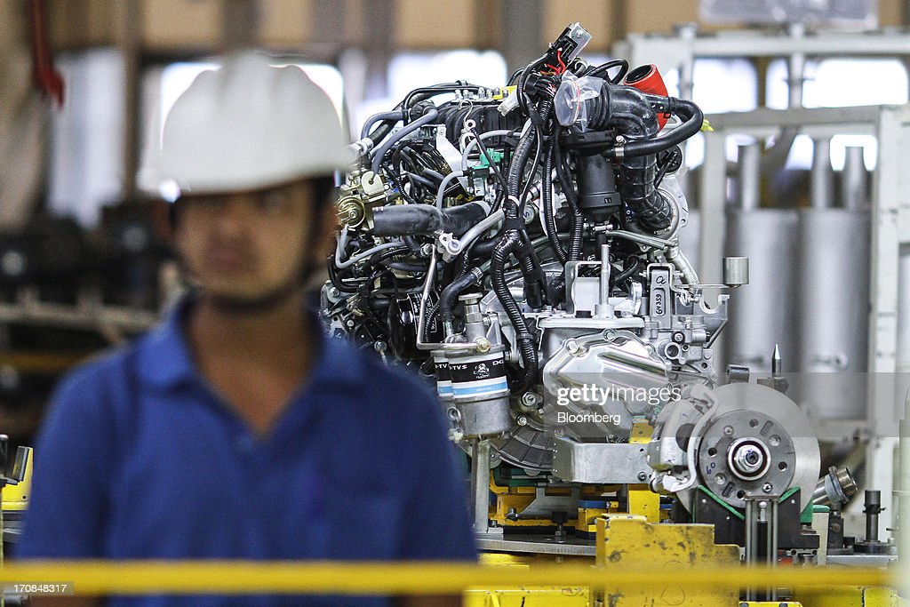 A Tata Motors Ltd. automobile engine sits on the assembly line of the company's factory in Pimpri, Maharashtra, India, on Wednesday, June 19, 2013. Tata Motors announced the introduction of 8 new models today. Photographer: Dhiraj Singh/Bloomberg via Getty Images