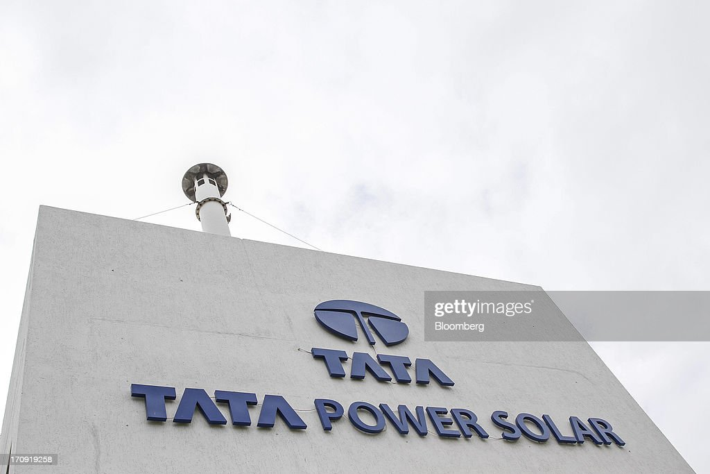 Tata Power Solar Systems Ltd. signage is displayed on the facade of the company's manufacturing plant in Bangalore, India, on Tuesday, June 11, 2013. Tata Groups solar unit is expanding its business building plants for customers, forecasting that offices and factories will be paying more for grid power than solar by 2016 in most Indian states. Photographer: Dhiraj Singh/Bloomberg via Getty Images