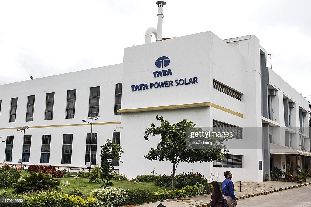 Tata Power Solar Systems Ltd. signage is displayed outside the company's manufacturing plant in Bangalore, India, on Tuesday, June 11, 2013. Tata Groups solar unit is expanding its business building plants for customers, forecasting that offices and factories will be paying more for grid power than solar by 2016 in most Indian states. Photographer: Dhiraj Singh/Bloomberg via Getty Images